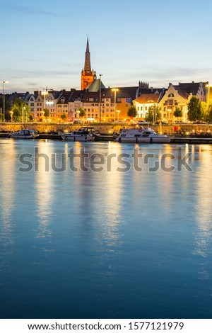 Cityscape with Odra river. Szczecin historical city with architectural layout similar to Paris. Castle of Pomeranian dukes in Szczecin and Basilica of Saint James Royalty-Free Stock Photo #1577121979