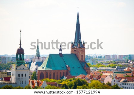 Cityscape with Odra river. Szczecin historical city with architectural layout similar to Paris. Castle of Pomeranian dukes in Szczecin and Basilica of Saint James Royalty-Free Stock Photo #1577121994