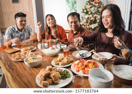 portrait of indonesian family having christmas eve dinner together at home #1577183764