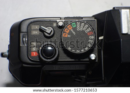 close up of Nikon F501's shutter button and speed control dial #1577210653