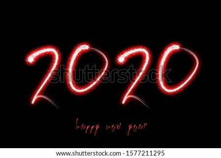 Happy New Year 2020 text written sparkles and fireworks on a black background