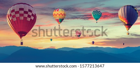 Beautiful landscape hot air balloons flying over sierra sky at sunset