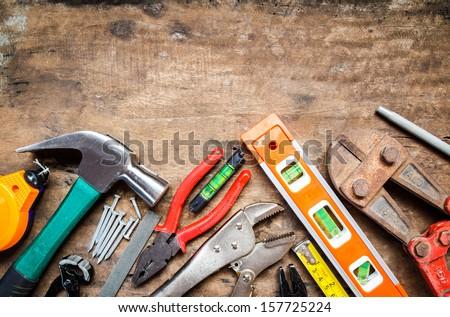 tool renovation on grunge wood Royalty-Free Stock Photo #157725224