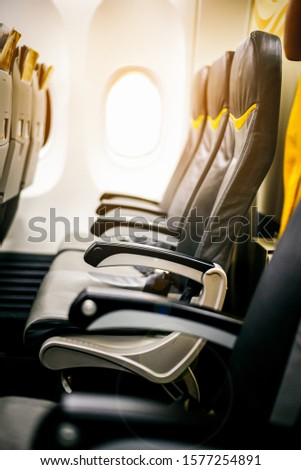 Empty seats and window inside an aircraft , Inside the plane in sunrise sky #1577254891