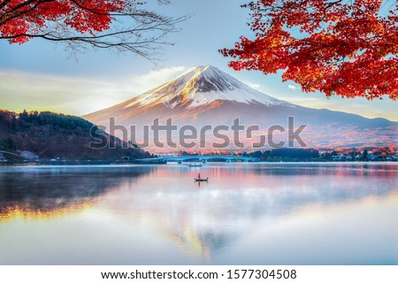 Fuji Mountain Reflection and Red Maple Leaves with Morning Mist in Autumn, Kawaguchiko Lake, Japan #1577304508