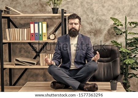 Prevent professional burnout. Man bearded manager formal suit sit lotus pose relaxing. Way to relax. Meditation yoga. Self care. Psychological help. Relaxation techniques. Mental wellbeing and relax. #1577363296