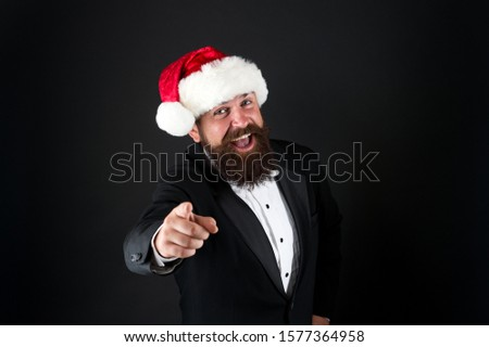 Naughty or nice. Happy Santa point finger at you. Christmas advertising. Focus on holiday advertising. Advertising product or event. Advertisement. Promotion and marketing. Festive advertising. #1577364958