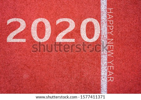 White lines of stadium and texture of running racetrack red rubber racetracks with 2020 Happy New Year text,During Christmas and New Year. #1577411371