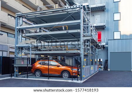 Tokyo. Japan. Multi-storey car parking. Modern parking in Tokyo. Street parking in Japan. Place to store cars. Saving urban space. Robotization. Japan urban. Car stands in an automatic car-park. #1577418193
