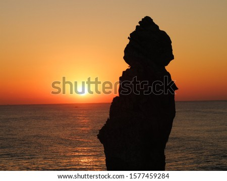 Because the earth rotates, you can see the sun rising before morning. The rising sun over the horizon or horizon is called sunrise. It is Chuam Candlestick Rock at sunrise. There is a spectacular view #1577459284