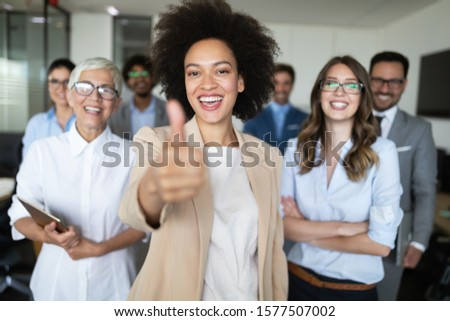 Successful group of business people at work in office #1577507002