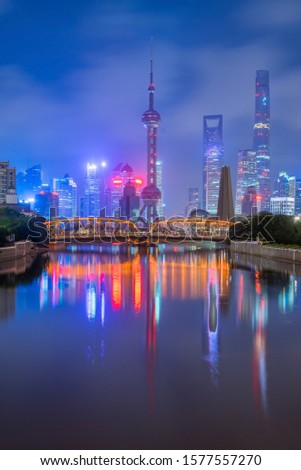 Urban architectural landscape of shanghai city skyline with huangpu river at dusk, Shanghai, China #1577557270