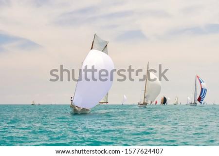 Sailboat under white sails at the regatta. Sailing yacht race #1577624407