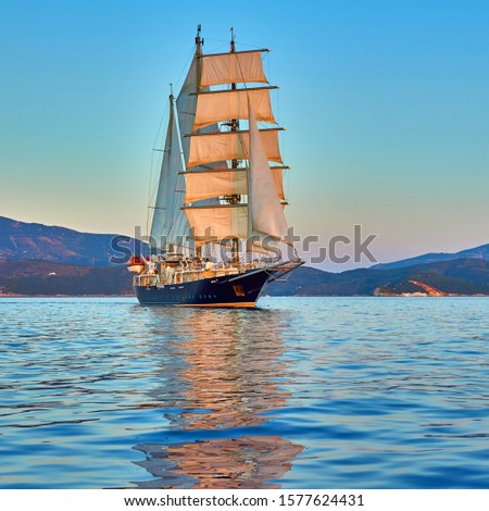 Sailing ship under white sails at the regatta. Yachting sport competition #1577624431
