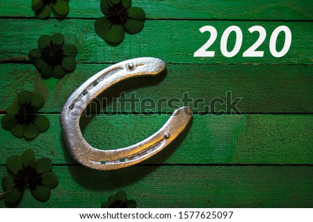new year wishes with a horseshoe and lucky clover #1577625097