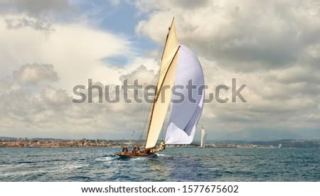 Sailboat under white sails at the regatta. Sailing yacht race #1577675602