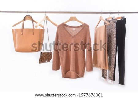 brown wool sweater with scarf, and brown, and snake pattern ,handbag with pants and black pants on hanger #1577676001
