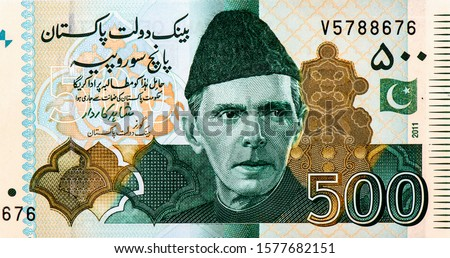 The Quaid-e-Azam Muhammad Ali Jinnah in National Dress i.e. Sherwani. Portrait from Pakistan 500 Rupees 2011 banknotes. An Old paper banknotes, vintage retro. Famous ancient Banknotes. Collection.  #1577682151