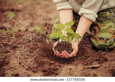 The young man plants a tree. #157768508