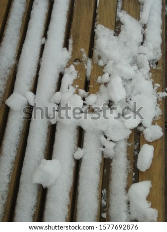 On the bench is the first snow. #1577692876