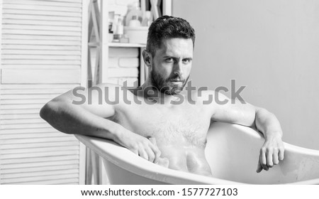Personal hygiene. Take care hygiene. Cleaning parts body. Hygiene concept. Man muscular torso sit in bathtub. Skin care. Hygienic procedure concept. Total relaxation. Bathing can improve heart health. #1577727103