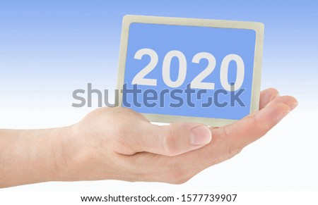 Male hands and 2020 label background #1577739907