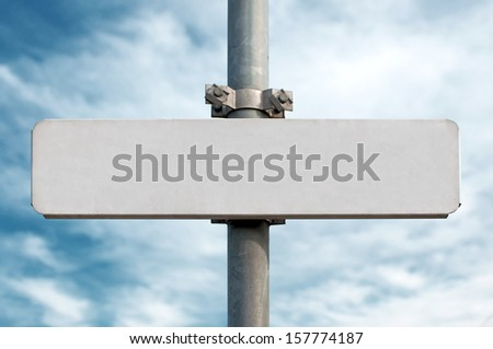 Empty street sign on metal post, cloudy sky in the background. #157774187