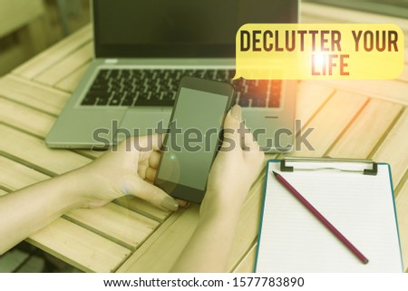 Handwriting text Declutter Your Life. Concept meaning To eliminate extraneous things or information in life woman laptop computer smartphone office supplies technological devices. #1577783890