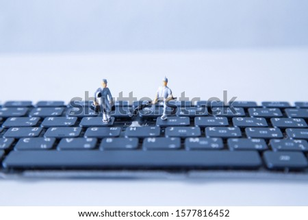 miniature people keyboard black repair, Concept: working in technical teams, technology systems, Behind the maintenance engineering, Computer Hardware Hardware for Laptops, closeup mini top view  #1577816452