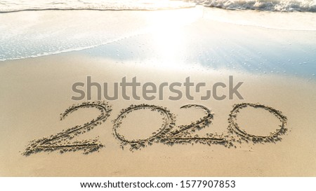 Picture of the concept of New Year's Eve 2020 welcome party on the sandy beach