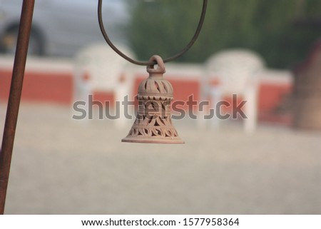 Abstract of a hanging decorative bell #1577958364