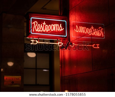 Neon restrooms sign at the train station. #1578055855