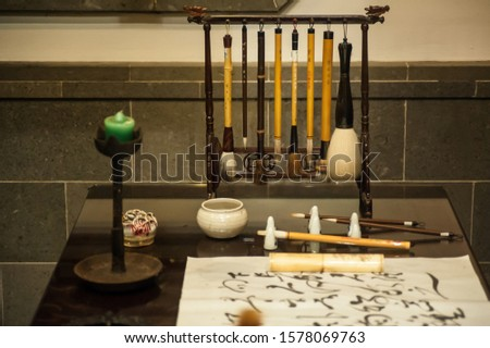 Calming Zen like calligraphy writing table and instruments  #1578069763
