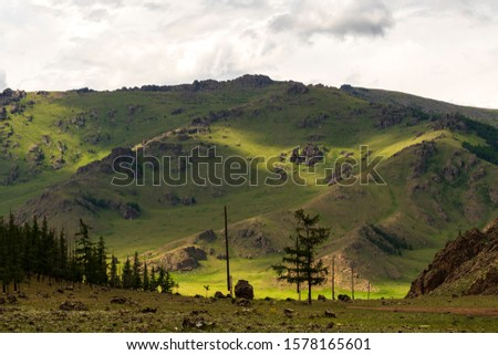 View of Mongolian landscape with mountains, shadow and clouds #1578165601