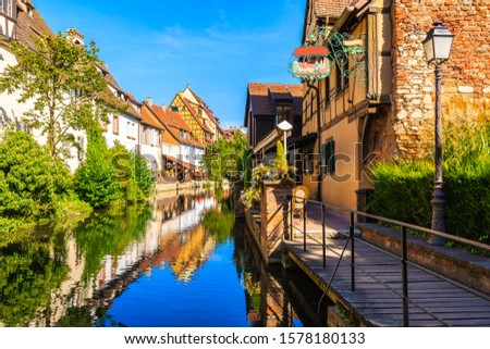 Colorful houses on street in picturesque Kintzheim village, Alsace Wine Route, France #1578180133