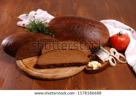 Rye bread. Rye bread with ingredients on a wooden table. #1578186688