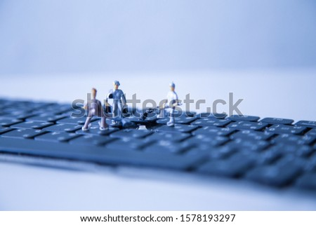 miniature people keyboard black repair, Concept: working in technical teams, technology systems, Behind the maintenance engineering, Computer Hardware Hardware for Laptops, closeup mini top view  #1578193297