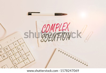 Text sign showing Complex Solution. Conceptual photo significant ideas that are completely or partly repressed White pc keyboard with empty note paper and pencil above white background. #1578247069