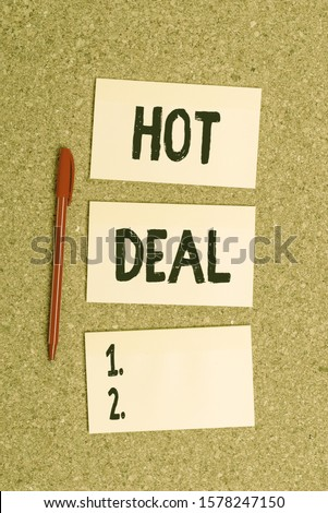 Conceptual hand writing showing Hot Deal. Business photo showcasing An agreement through which one of the paties is offered and accept Empty sticker reminder memo billboard corkboard desk paper. #1578247150