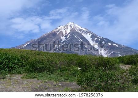 Panoramic view of the city Petropavlovsk-Kamchatsky and volcanoes: Koryaksky Volcano, Avacha Volcano, Kozelsky Volcano. Russian Far East, Kamchatka Peninsula. #1578258076