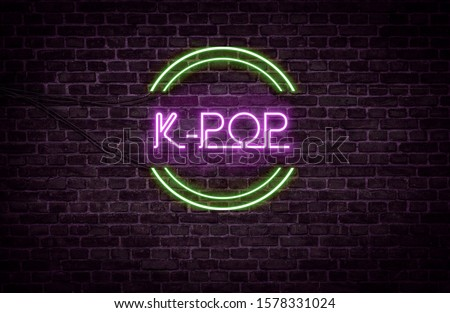 A green and purple neon light sign that reads: K-POP Royalty-Free Stock Photo #1578331024