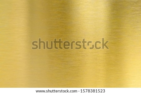 Saturated golden metal brushed texture plate Royalty-Free Stock Photo #1578381523
