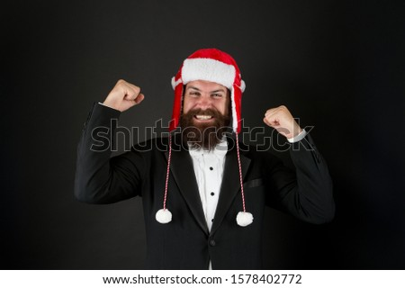 Success gesture. Business santa wish you financial growth. Businessman Santa in jacket. Christmas party concept. Feeling warmth. Business corporate. Man with beard in smart suit and Santa hat. #1578402772
