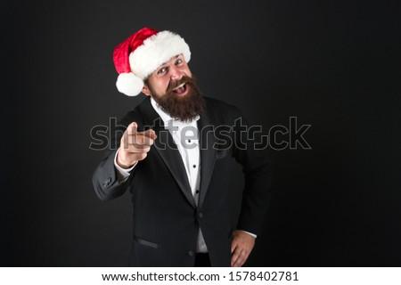 Secret Santa sale. Happy businessman point finger. Christmas sale and discount. Seasonal sale. Low prices. Big savings. Enjoy reduction and sale. Xmas special. Lets shop, copy space. #1578402781