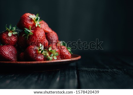 Horizontal photo of strawberries on a black background
