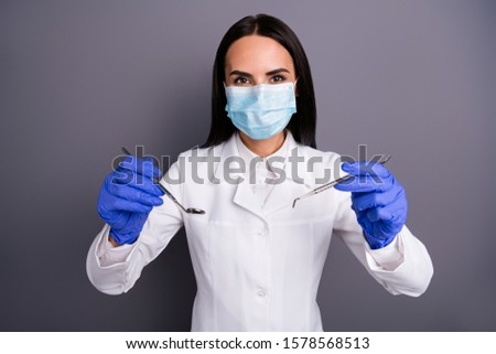 Portrait of confident expert dentist girl use sterile medico equipment have stomatology procedure want examine patient oral cavity wear white coat uniform isolated grey color background #1578568513
