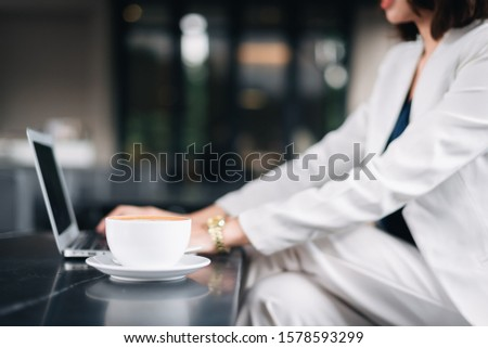 Businesswoman Working On Laptop In Coffee Shop. Young business woman uses laptop in cafe. Asian woman. #1578593299