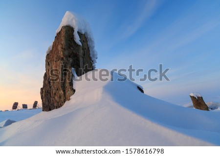 Winter landscape with snow-covered rock. In the distance, tropospheric communication antennas are visible. The nature of the Arctic. Location place: Chukotka, Siberia, Russian Far East. Polar region. #1578616798