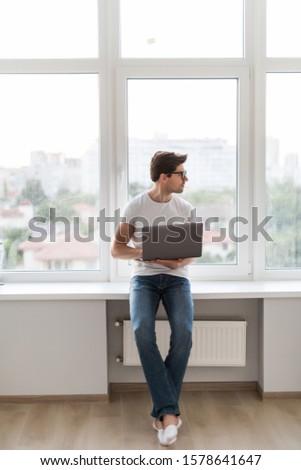 handsome hipster modern man designer working home using laptop at home #1578641647
