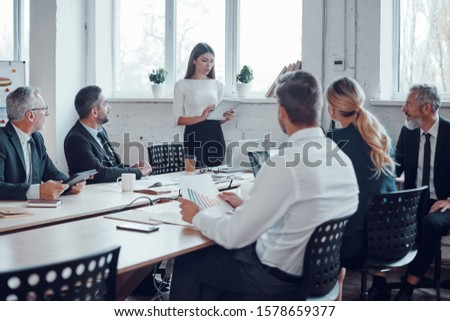 Professional business expert conducting meeting while working together with colleagues in the modern office #1578659377